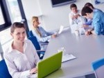 16581451-group-of-happy-young-business-people-in-a-meeting-at-office